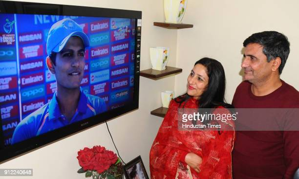 Lakhwinder Singh and Kirath Gill parents of cricketer Shubman Gill watching their son as he scored an unbeaten 102 runs against Pakistan in U19 World...