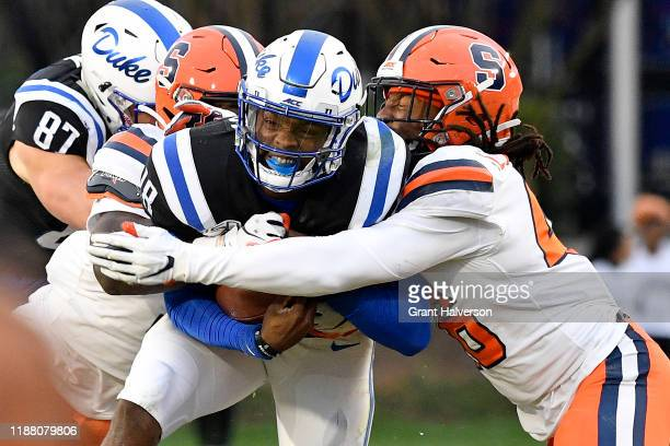 Lakiem Williams of the Syracuse Orange tackles Quentin Harris of the Duke Blue Devils during the first half of their game at Wallace Wade Stadium on...