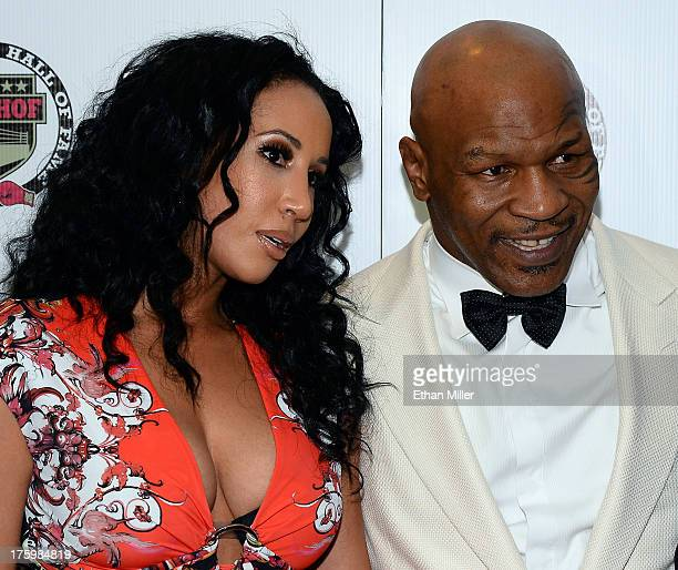 """Lakiha """"Kiki"""" Tyson and her husband, former boxer and inductee Mike Tyson, arrive at the Nevada Boxing Hall of Fame inaugural induction gala at the..."""