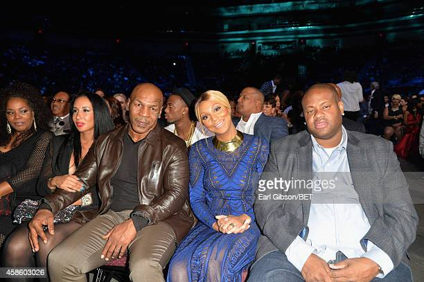 Lakiha Spicer boxer Mike Tyson recording artist Tamar Braxton recording executive Vincent Herbert attend the 2014 Soul Train Music Awards at the...