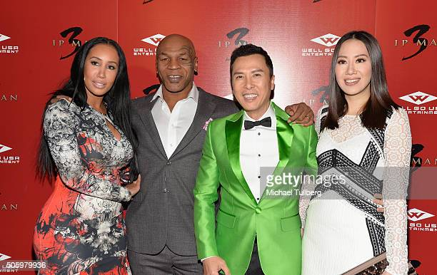 """Lakiha Spicer, former heavyweight boxing champion Mike Tyson, actor Donnie Yen and Cecilia Wang attend the premiere of Well Go USA's """"Ip Man 3"""" at..."""