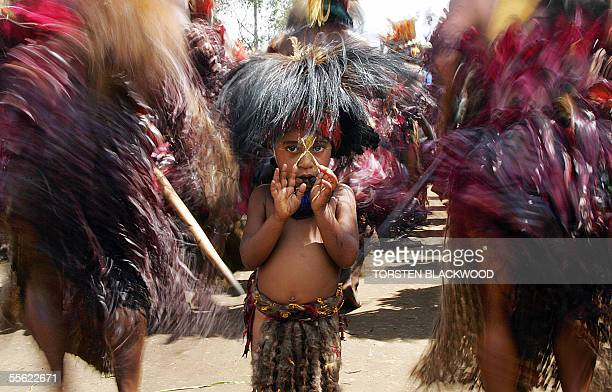 Lakoku boy waits among his tribe to enter the Goroka singsing in the Southern Highlands 16 September 2005 Over 60 tribes from all over Papua New...