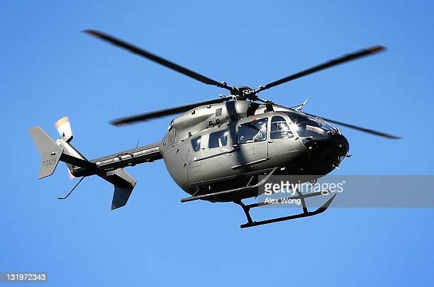 Lakota helicopter participates in a flyover during the group burial service of Army Capt Arnold E Holm Jr of Waterford Connecticut Spc Robin R...