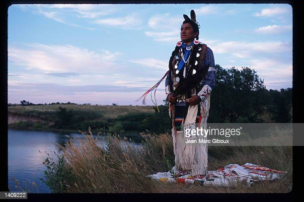 Lakota Indian Florentine Blue Thunder watches the sun set August 1 1996 in the Black Hills region of South Dakota Sioux tribe members continue to...