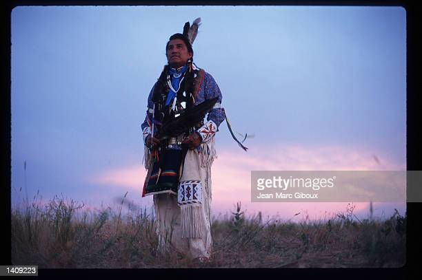 Lakota Indian Florentine Blue Thunder watches the sun set August 1, 1996 in the Black Hills region of South Dakota. Sioux tribe members continue to...