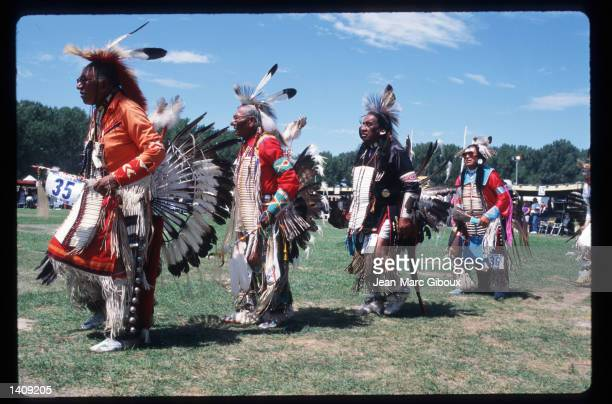 Lakota Indians participate in a pow-wow August 1, 1996 in the Black Hills region of South Dakota. Sioux tribe members continue to fight the US...
