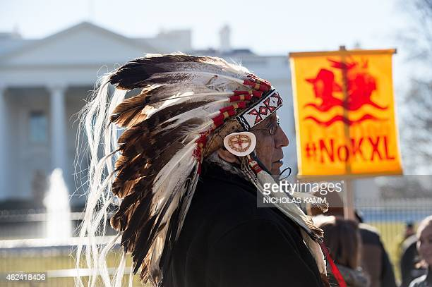 Lakota spiritual leader Chief Arvol Looking Horse attends a demonstration against the proposed Keystone XL pipeline from Canada to the Gulf of Mexico...