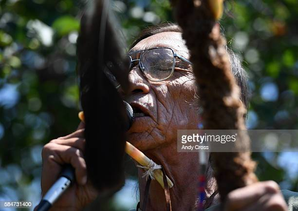 Lakota tribe Elder Gilly Running gives a traditional blessing for fellow Lakota tribe members friends and supporters gathered in front of Fairview...