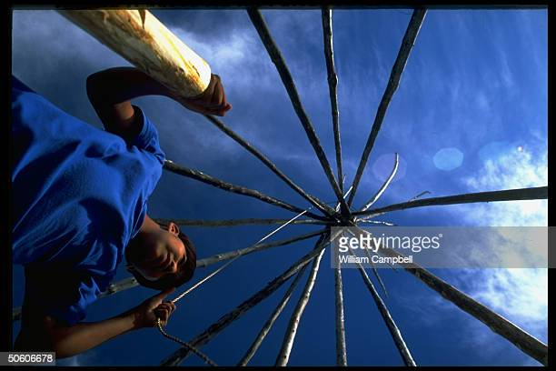 Lakota youth learning to put up tepee at Wolakota Yukini Wicoti Healthy Nations summer camp for Sioux teens imperiled by drug alcohol abuse Cheyenne...