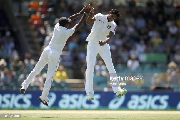 Lakshan Sandakan and Kasun Rajitha of Sri Lanka celebrate Rajitha taking the wicket of Marnus Labuschagne of Australiaduring day three of the Second...