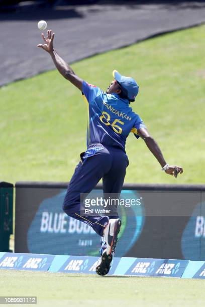 Lakshan Sandakan of Sri Lanka takes a catch on the boundary to dismiss Kane Williamson of the New Zealand Blackcaps during game two in the One Day...