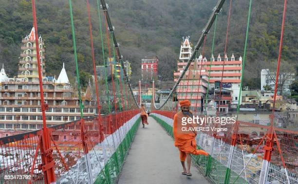 Lakshman Jhula one of the two suspension bridges on march 302017 in Rishikesh India