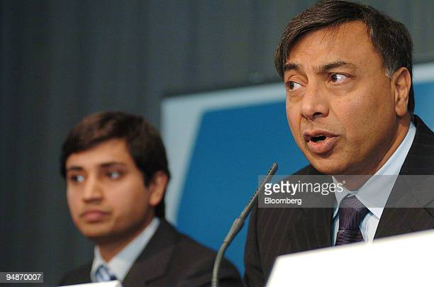 Lakshmi Mittal chairman and chief executive of Mittal Steel Co right speaks at a press conference watched by Aditya Mittal group financial officer in...