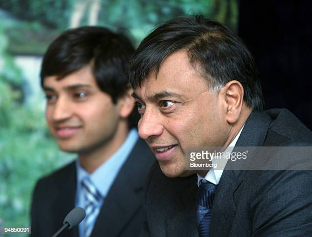 Lakshmi Mittal chairman and chief executive officer right and Aditya Mittal president and chief financial officer Mittal Steel Co are seen at a news...