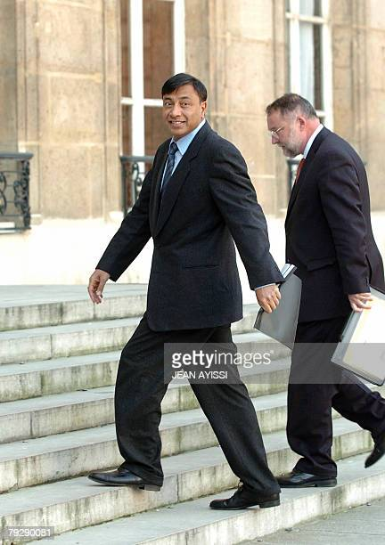 Lakshmi Mittal chief executive of steel giant ArcelorMittal arrives with Daniel SouryLavergne ArcelorMittal France general director for talks with...