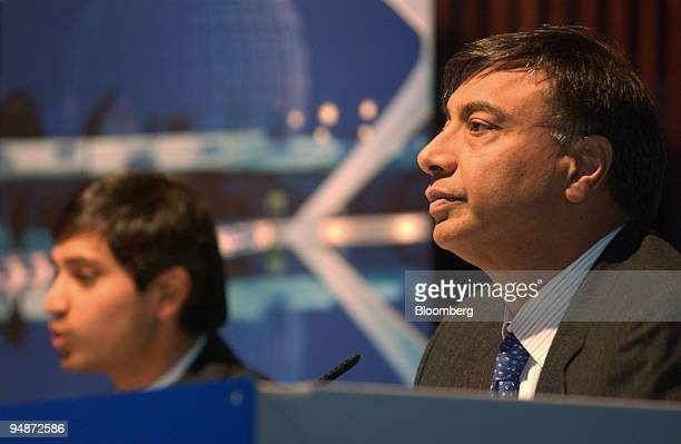Lakshmi Mittal right chairman and chief executive officer at Mittal Steel Co and Aditya Mittal president and chief financial officer speak at a news...