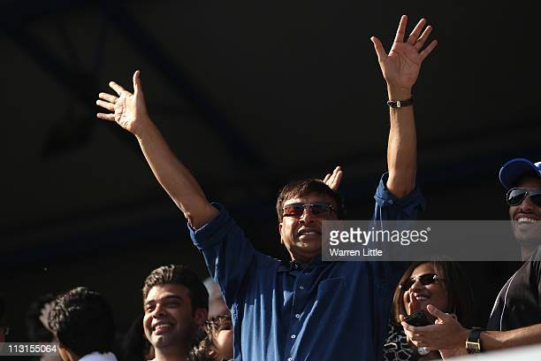 Lakshmi Mittal the CEO and Chairman of ArcelorMittal is cheered by Queens Park Rangers fans on the pitch after the 11 result in the npower...