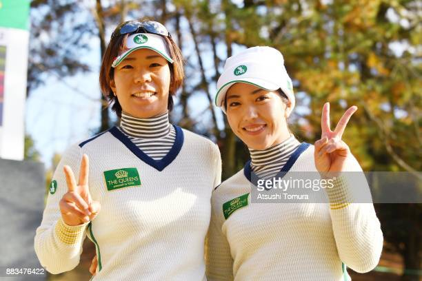Lala Anai and Ritsuko Ryu of Japan pose for photographers after winning their match during the first round of the Queens at Miyoshi Country Club on...