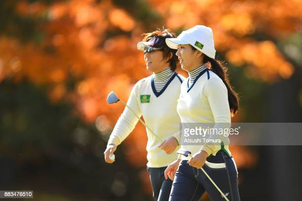 Lala Anai and Ritsuko Ryu of Japan smile after winning their match during the first round of the Queens at Miyoshi Country Club on December 1 2017 in...