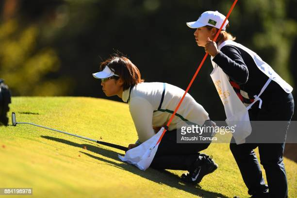 Lala Anai of Japan lines up her putt on the 16th hole during the second round of the Queens at Miyoshi Country Club on December 2 2017 in Miyoshi...