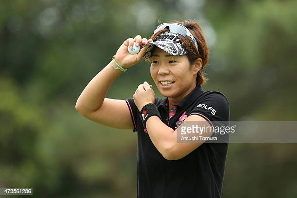 Lala Anai of Japan smiles after making her birdie putt on the 17th green during the second round of the HokennoMadoguchi Ladies at the Fukuoka...
