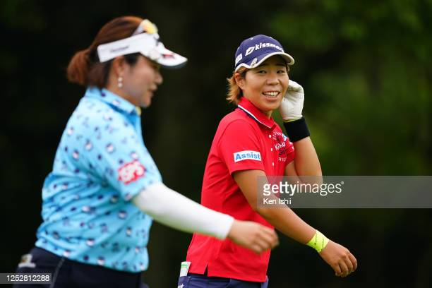 Lala Anai of Japan talks with Miki Sakai of Japan after their tee shots on the 6th hole during the third round of the Earth Mondamin Cup at the...