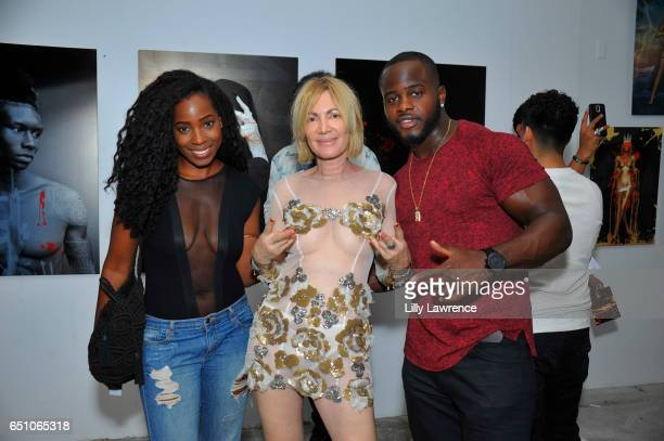 Lala Housey artist Karen Bystedt and professional football player Jerry Housey attend Karen Bystedt's 'Kings And Queens' exhibition on March 9 2017...