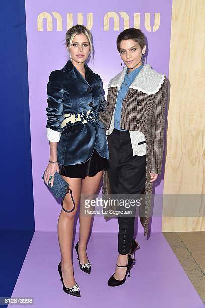 Lala Rudge and a guest attend the Miu Miu show as part of the Paris Fashion Week Womenswear Spring/Summer 2017 on October 5 2016 in Paris France