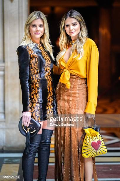 Lala Rudge and Thassia Naves attend the Balmain show as part of the Paris Fashion Week Womenswear Spring/Summer 2018 on September 28 2017 in Paris...