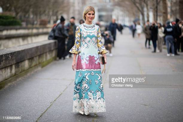 Lala Rudge is seen wearing dress with print outside Valentino during Paris Fashion Week Womenswear Fall/Winter 2019/2020 on March 03 2019 in Paris...