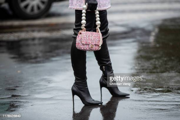 Lala Rudge seen wearing gloves, black overknees boots outside Chanel during Paris Fashion Week Womenswear Spring Summer 2020 on October 01, 2019 in...