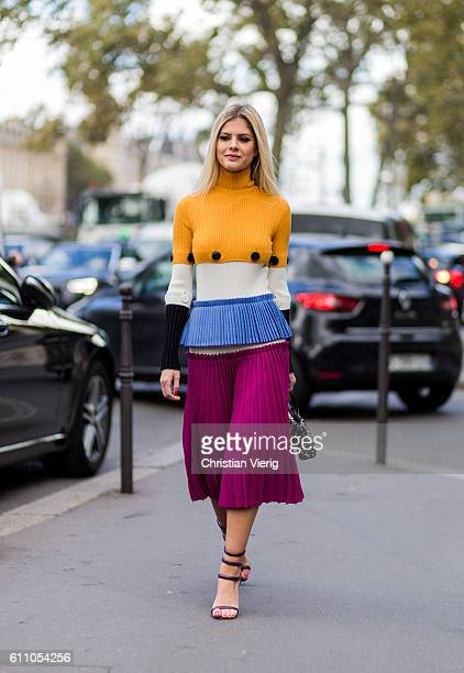 Lala Rudge wearing a Ferragamo dress and Fendi bags outside Lanvin on September 28 2016 in Paris France