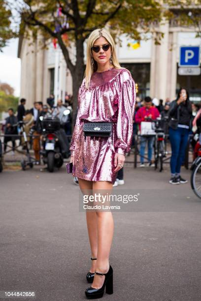 Lala Rudge wearing a pink sequin mini dress black heels and black fanny pack is seen before the Miu Miu show on October 2 2018 in Paris France