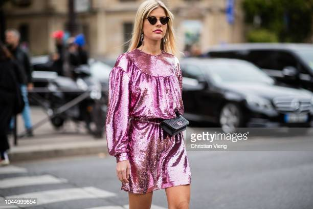 Lala Rudge wearing pink glitter dress, fanny bag is seen outside Miu Miu during Paris Fashion Week Womenswear Spring/Summer 2019 on October 2, 2018...