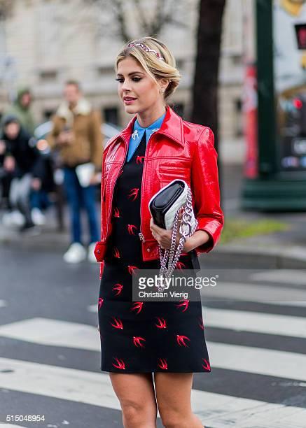 Lala Rudge wearing red Miu Mku heels leather jacket and dress outside Miu Miu during the Paris Fashion Week Womenswear Fall/Winter 2016/2017 on March...