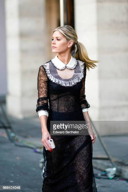 Lala Rudge wears a black lace mesh dress with white collar outside the Miu Miu Cruise Collection show outside the Hotel Regina in Paris on June 30...