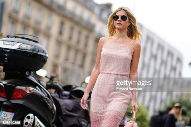 Lala Rudge wears a pink dress red boots outside Giambattista Valli during Paris Fashion Week Womenswear Spring/Summer 2018 on October 2 2017 in Paris...