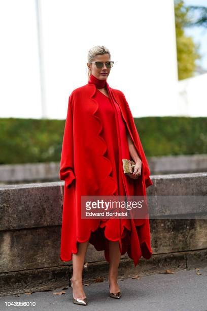Lala Rudge wears a red dress outside Valentino during Paris Fashion Week Womenswear Spring/Summer 2019 on September 30 2018 in Paris France