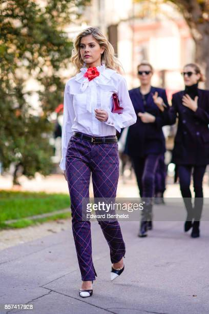 Lala Rudge wears a white shirt a red clutch purple pants outside Moncler during Paris Fashion Week Womenswear Spring/Summer 2018 on October 3 2017 in...