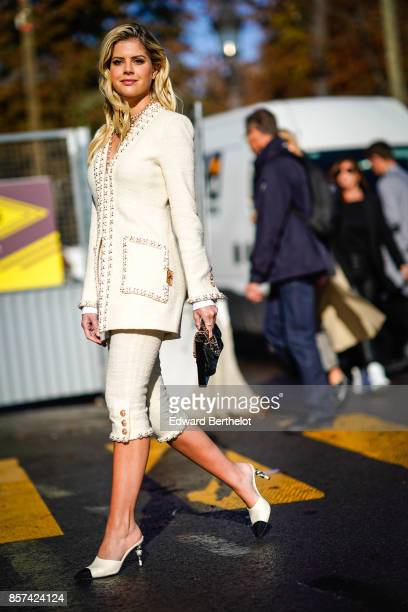 Lala Rudge wears a white tweed jacket a white skirt a clutch outside Chanel during Paris Fashion Week Womenswear Spring/Summer 2018 on October 3 2017...