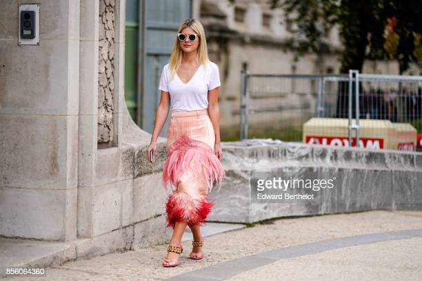 Lala Rudge wears sunglasses a white tshirt a pink skirt with fringes outside Elie Saab during Paris Fashion Week Womenswear Spring/Summer 2018 on...