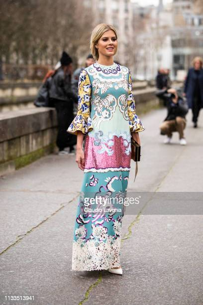 Lala Trussardi Rudge wearing a long colorful dress white heels and gold Valentino bag is seen outside Valentino on Day 7 Paris Fashion Week...