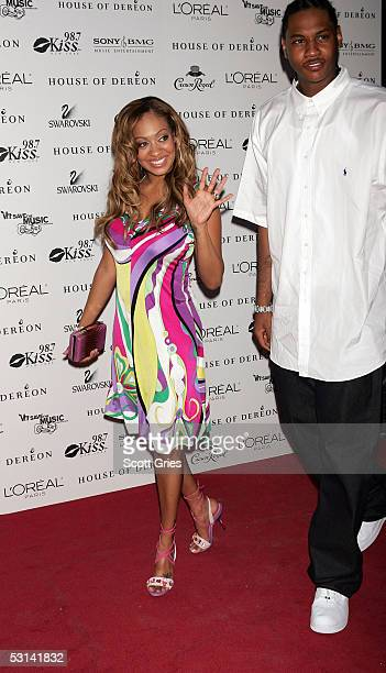 LaLa Vasquez and basketball player Carmelo Anthony arrive at the Beyonce Beyond the Red Carpet auction presented by Beyonce and her mother Tina...
