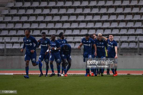 Lalaina Henintsoa Nomenjanahary of Paris FC celebrates his goal with team mates during the French Ligue 2 Football match between Paris FC and AC...