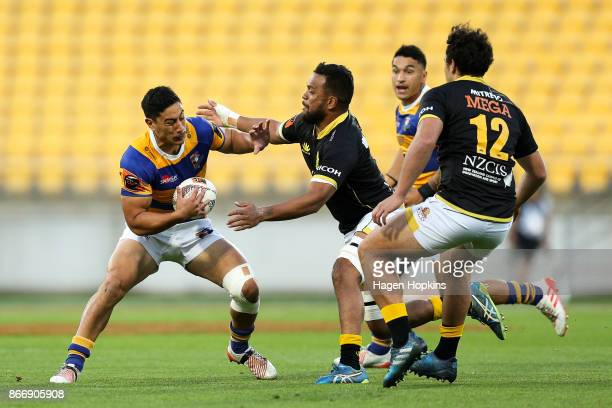 Lalakai Foketi of Bay of Plenty is tackled by Mateaki Kafatolu of Wellington during the Mitre 10 Cup Championship Final match between Wellington and...