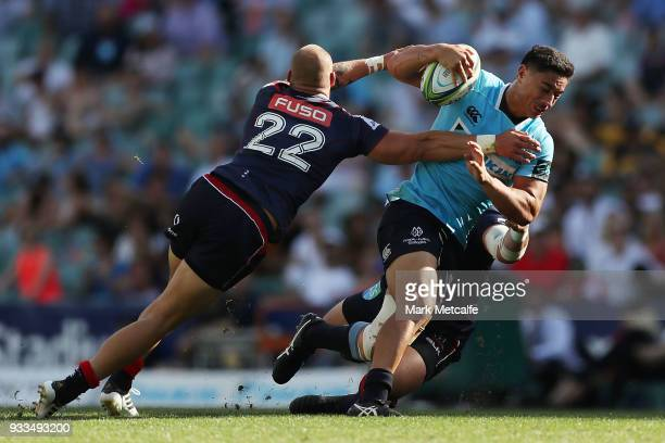 Lalakai Foketi of the Waratahs is tackled by Bill Meakes of the Rebels during the round five Super Rugby match between the Waratahs and the Rebels at...