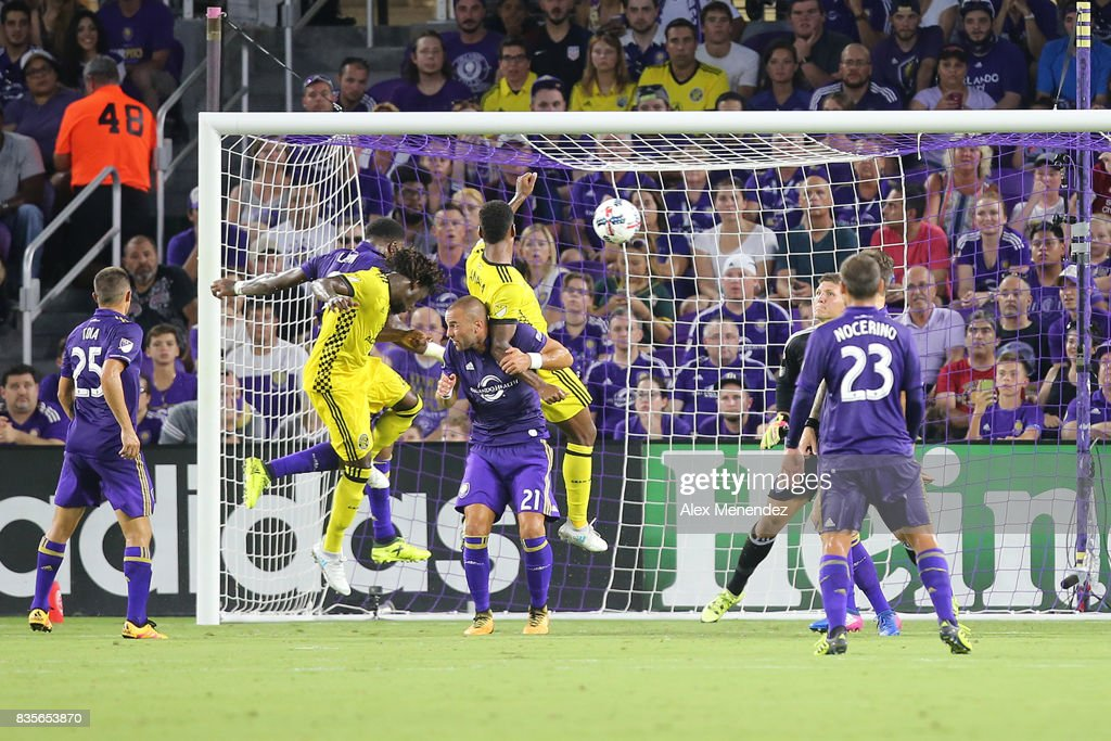 Lalas Abubakar #17 of Columbus Crew SC heads the ball for a goal in front of Scott Sutter #21 of Orlando City SC during a MLS soccer match between the Columbus Crew SC and the Orlando City SC at Orlando City Stadium on August 19, 2017 in Orlando, Florida.