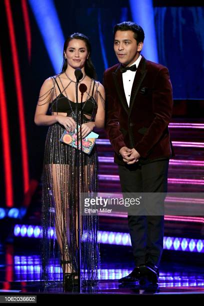 Lali and Christian Nodal speak onstage during the 19th annual Latin GRAMMY Awards at MGM Grand Garden Arena on November 15 2018 in Las Vegas Nevada