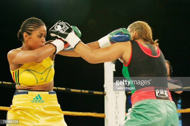 Lalia Ali of the USA fights against Gwendolyn O'Neil of Guyana during the WBC/WIBA Super Middleweight World Title bout at Emperors Palace February 3...