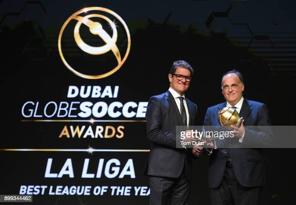 LaLiga President Javier Tebas Mendrano is presented with Best League of the Year Award by Fabio Capello during the Globe Soccer Awards 2017 on...
